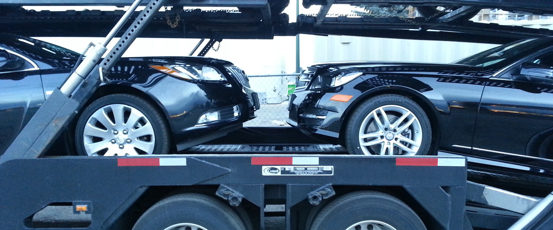 2 sedans meeting in the trailer face to face